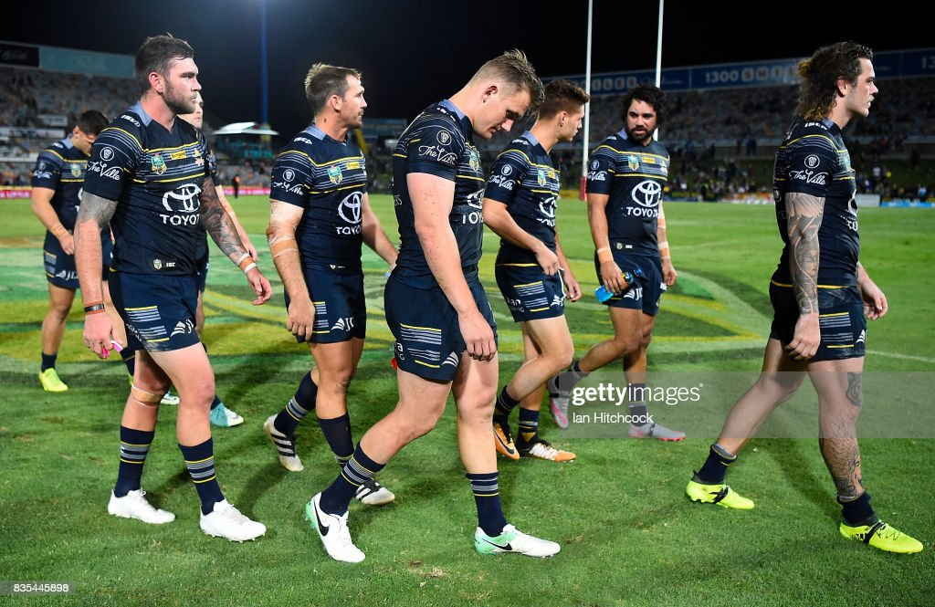 The Cowboys walk from the field after losing the round 24 NRL match between the North Queensland Cowboys and the Cronulla Sharks at 1300SMILES Stadium on August 19, 2017 in Townsville, Australia.