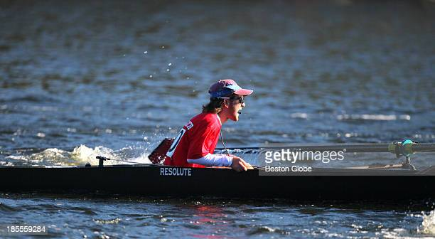 The coxswain from the number 28 boat of Rutgers University motivates her crew in the Championship Men's Eights during the 2013 Head of the Charles...