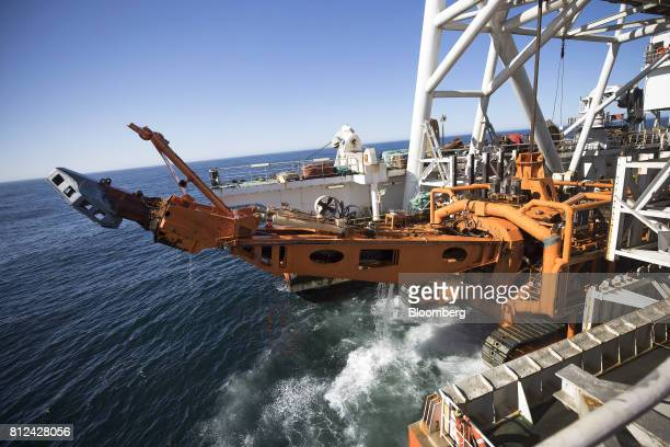 The 'crawler' tractor drops into the sea from the deck of the Mafuta diamond mining vessel operated by Debmarine Namibia a joint venture between De...
