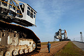 The crawler-transporter moves away after carrying space shuttle Discovery to the launch pad.