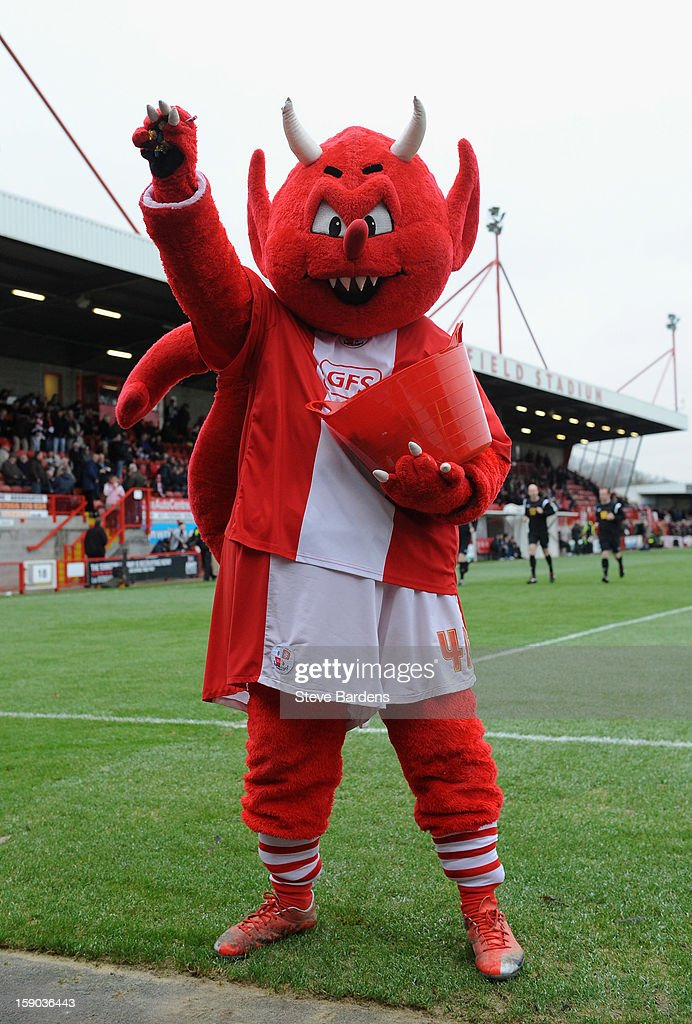 The Crawley Town mascot throws sweets into the crowd prior to the FA Cup with Budweiser Third Round match between Crawley Town and Reading at Broadfield Stadium on January 5, 2013 in Crawley, West Sussex.