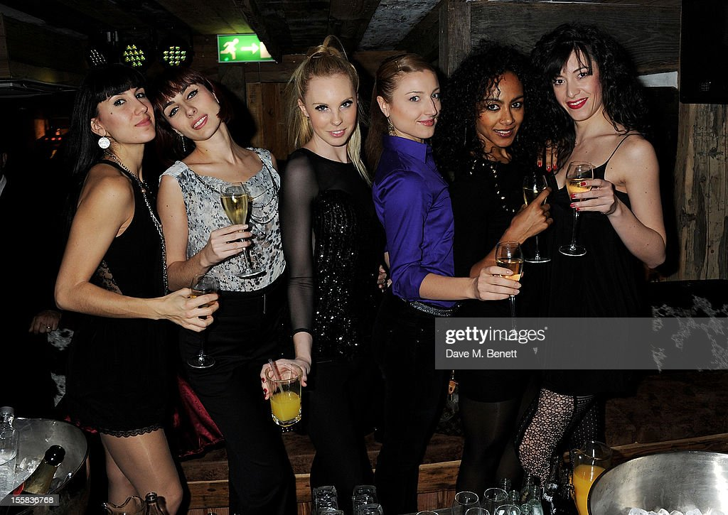 The Crazy Horse performers attend a party at Piers Adam's new restaurant Bodo's Schloss with Kelly Brook on High Street Kensington on November 8, 2012 in London, England.