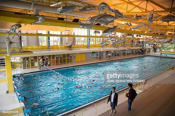 The creation 'Mes tripes sont des poissons d'argent' by French artist Julien Salaud is pictured on June 30 2016 at a swimming pool in Nantes western...