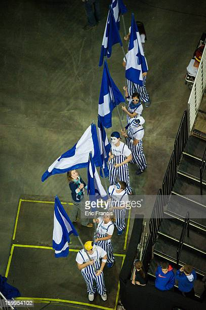 The Creighton Bluejay flag bearers wait to lead the team to the floor against the Northern Iowa Panthers at the CenturyLink Center on January 15 2013...