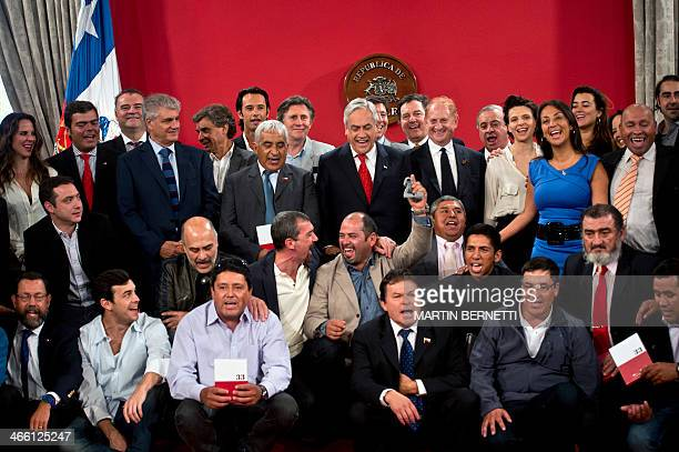 The crew and actors of the film 'Los 33' pose with Chilean President Sebastian Pinera and rescued miner Mario Sepulveda at La Moneda presidential...