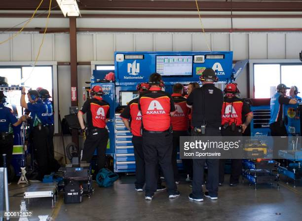 The crew for Dale Earnhardt Jr watch the TV feed during the Toyota/Save Mart 350 practice on June 23 2017 at Sonoma Raceway in Sonoma CA