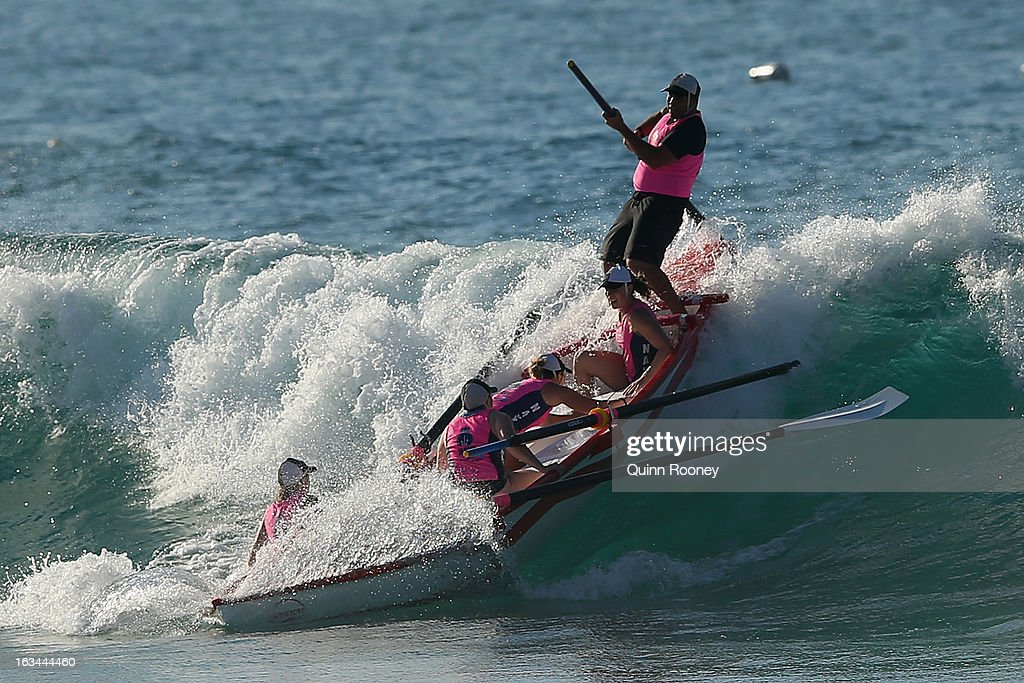 The crew from Lorne catch a wave in the surf boat race during the Victorian Surf Lifesaving Championships on March 10, 2013 in Anglesea, Australia.