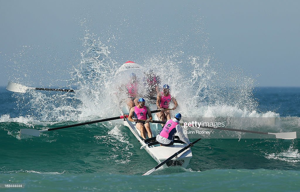 The crew from St Kilda crash through a wave in the surf boat race during the Victorian Surf Lifesaving Championships on March 10, 2013 in Anglesea, Australia.
