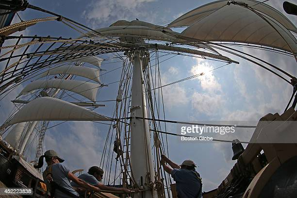 The crew hoist sails by Boston Harbor onboard the Charles W Morgan as it sails from Provincetown to Boston