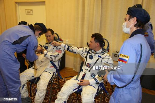 The crew members of the next expedition to the International Space Station Russian cosmonaut Roman Romanenko and US astronaut Tom Marshburn put on...