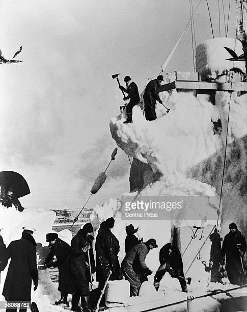The crew of a British destroyer clear the snow and ice from her decks whilst on convoy escort duty in the North Atlantic 11th April 1943