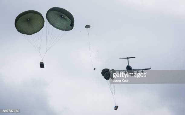 The crew of a C17 transport plane drops heavy equipment during the 'Swift Response 172' military exercises hosted by the US Army on October 10 2017...