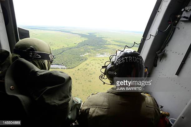 The crew of a helicopter during an operation to destroy clandestine airstrip used by drug traffickers in Apure 45km from the border with Colombia on...