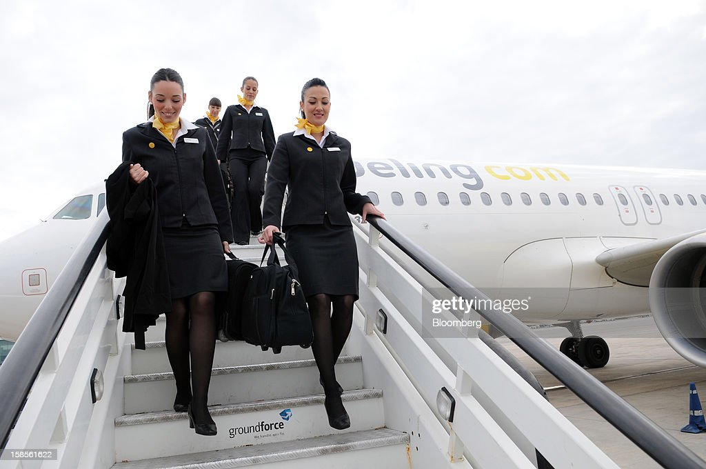 The crew of an Airbus A320 aircraft operated by Vueling Airlines SA disembarks at EL Prat airport in Barcelona, Spain, on Wednesday, Dec. 19, 2012. International Consolidated Airlines Group SA won't require European Union approval to buy 100 percent of low-cost carrier Vueling Airlines SA, the EU's antitrust chief said. Photographer: Stefano Buonamici/Bloomberg via Getty Images
