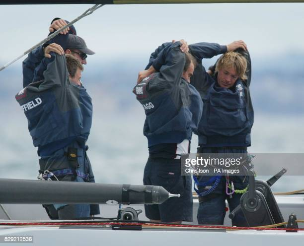 The crew of Britain's America's Cup yacht Wight Lightning limber up before the start of their race against Oracle BMW in the Hauraki Gulf off...