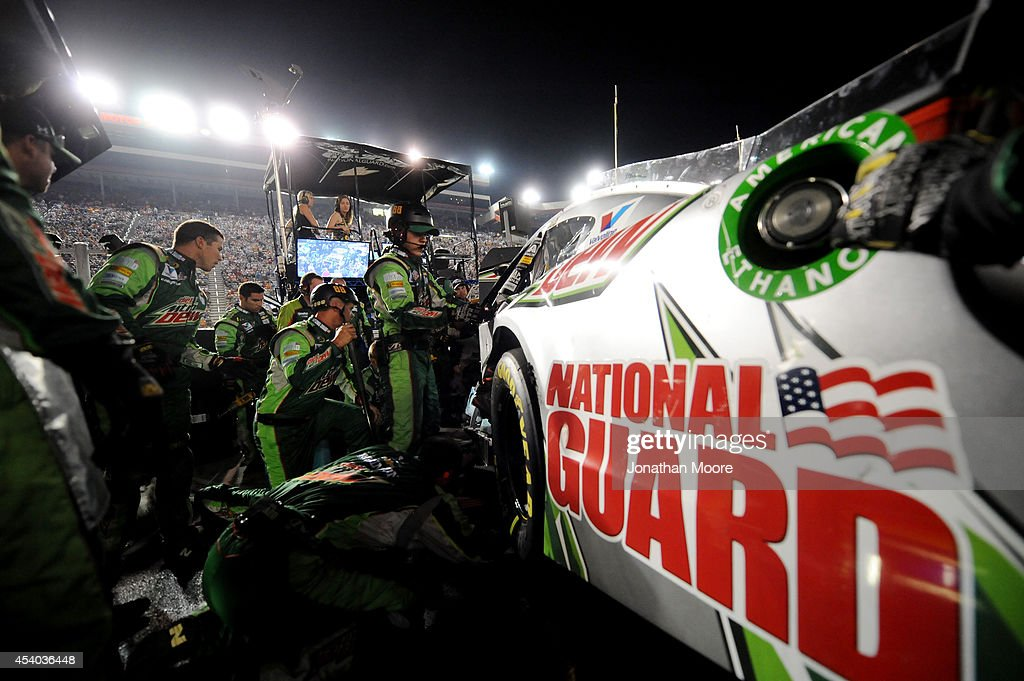 The crew of Dale Earnhardt Jr., driver of the #88 Diet Mountain Dew Chevrolet, work on the car following an incident on track during the NASCAR Sprint Cup Series Irwin Tools Night Race at Bristol Motor Speedway on August 23, 2014 in Bristol, Tennessee.