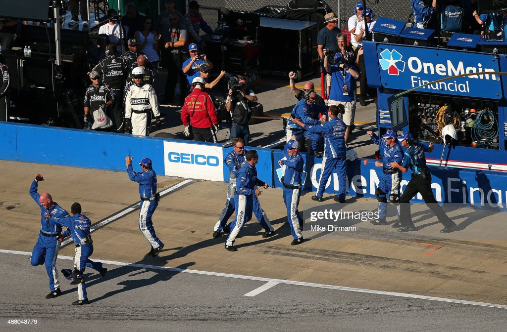 The crew of Elliott Sadler, driver of the #11 OneMain Financial Toyota, celebrates after winning the NASCAR Nationwide Series Aaron's 312 at Talladega Superspeedway on May 3, 2014 in Talladega, Alabama.