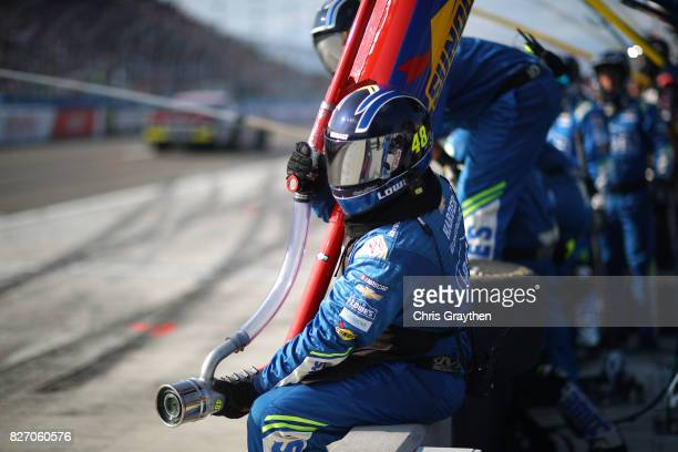 The crew of Jimmie Johnson driver of the Lowe's Chevrolet prepares for a pit stop during the Monster Energy NASCAR Cup Series I Love NY 355 at The...