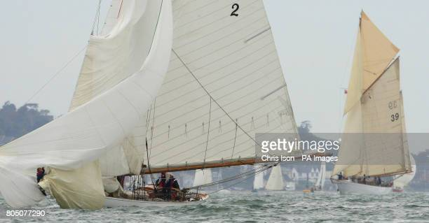 The crew of Kelpie get to grips with a spinnaker problem as they compete in the British Classic Yacht Club regatta on The Solent near Cowes Isle of...