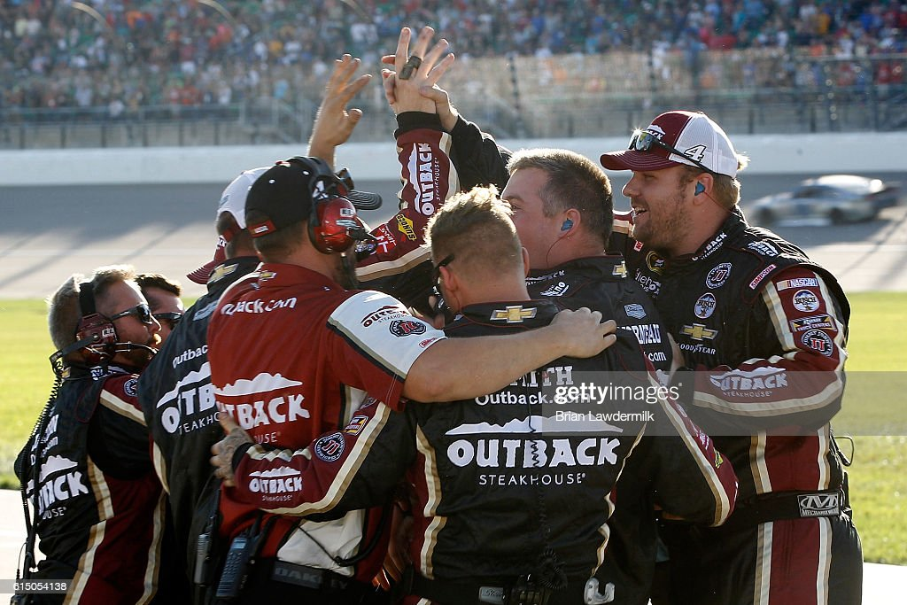 The crew of Kevin Harvick(not pictured), driver of the #4 Outback Chevrolet, celebrates on pit road after winning the NASCAR Sprint Cup Series Hollywood Casino 400 at Kansas Speedway on October 16, 2016 in Kansas City, Kansas.