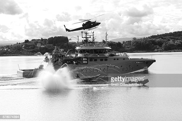 The crew of Royal Norwegian Coast Guard patrol boat KV Tor W334 simulates being a skiff taken over by pirates as Royal Norwegian Marinejaggers use...