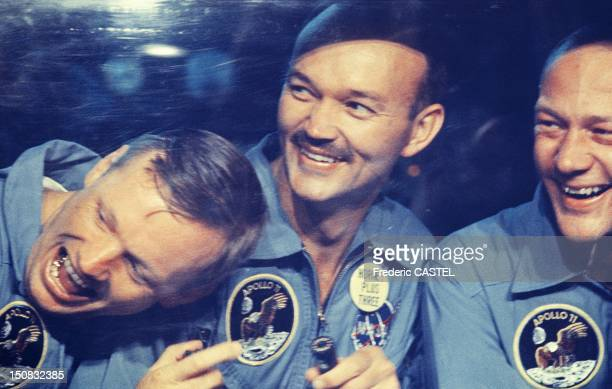 The crew of the Apollo 11 moon landing mission the astronauts Neil Armstrong Michael Collins and Edwin Aldrin are in quarantine after their return...