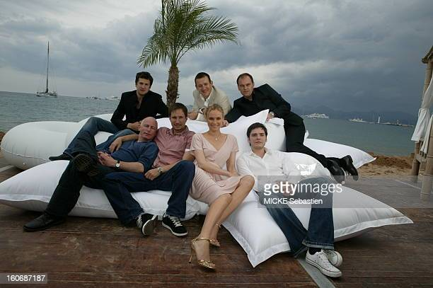 The crew of the film 'Merry Christmas' by Christian Caron posing on the beach of the Market across from Miramar CANNES from left to right and top to...