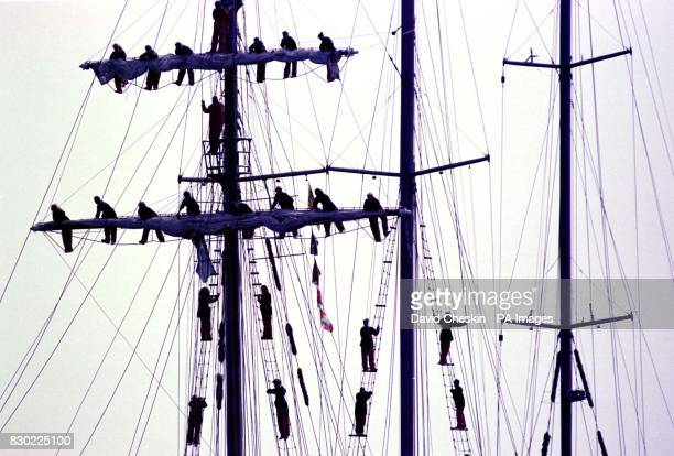 The crew of the Malcolm Miller built in Aberdeen climb in the rigging as she arrives in Greenock for a weekend break during the Cutty Sark Tall Ships...