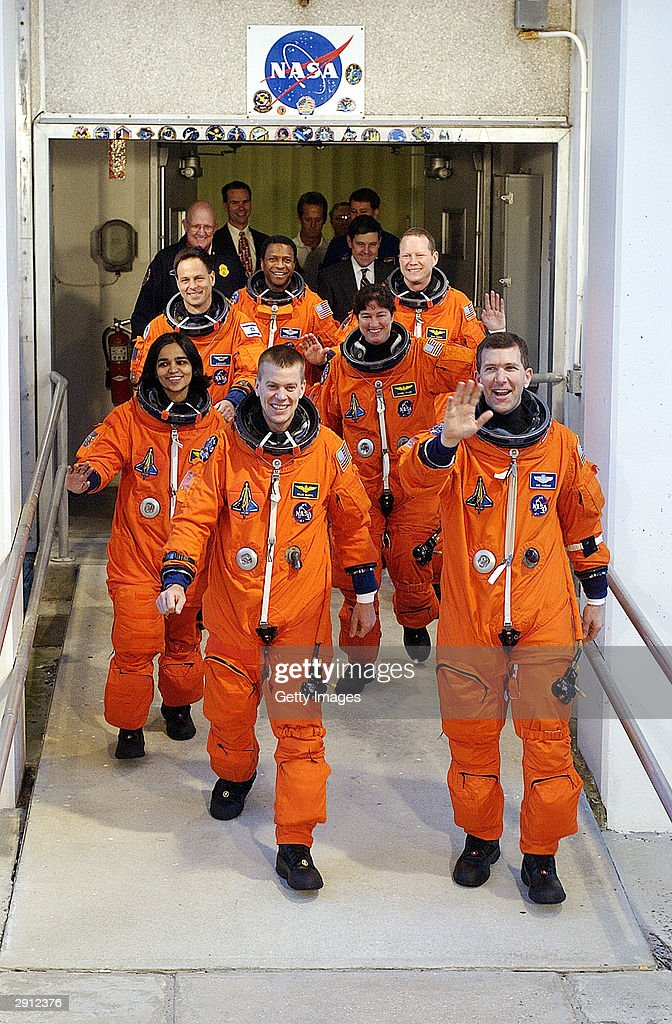 The crew of the Space Shuttle Columbia for mission STS-107, in the first row, Pilot William 'Willie' McCool (L) and Commander Rick Husband (R), second row are Mission Specialists <a gi-track='captionPersonalityLinkClicked' href=/galleries/search?phrase=Kalpana+Chawla&family=editorial&specificpeople=2264306 ng-click='$event.stopPropagation()'>Kalpana Chawla</a> (left) and Laurel Clark (R) in the last row, Payload Specialist Ilan Ramon, Payload Commander Michael Anderson and Mission Specialist David Brown walk to the launch pad on January 16, 2003 at Kennedy Space Center at Cape Canaveral, Florida. Mission STS-107 is a 16-day scientific mission. The one-year anniversary of the space shuttle Columbia disaster during re-entry will be marked February 1, 2004.