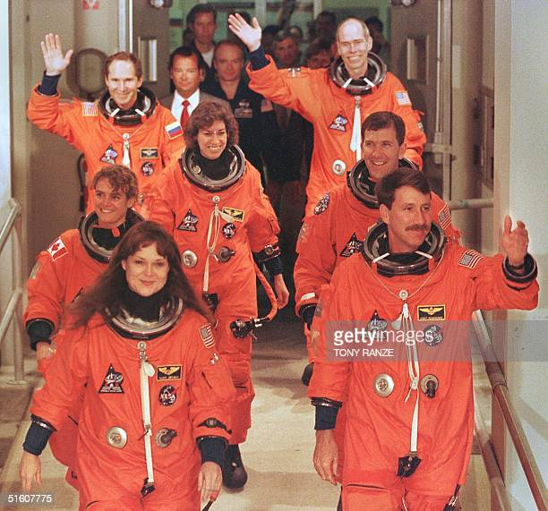 The crew of the Space Shuttle Discovery Mission Specialist Tamara Jernigan Commander Kent Rominger Mission Specialist Julie Payette from Canada...
