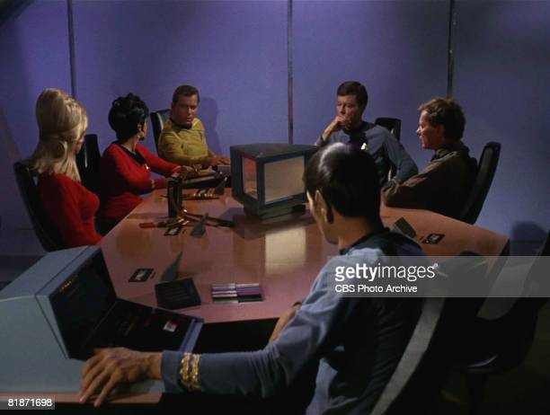 The crew of the Starship Enterprise sit around a table in a scene from 'The Man Trap' the premiere episode of 'Star Trek' which aired on September 8...