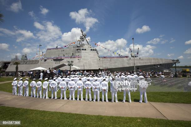 The crew of the USS Gabrielle Giffords stands at the ready prior to the commissioning ceremony on June 10 2017 in Galveston Texas The US Navy...