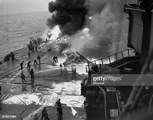 The crew of the USS Saratoga tries to get fires caused by Japanese planes under control near Iwo Jima ca 1945   Location USS Saratoga near Iwo Jima...