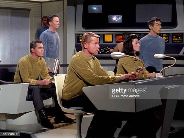 The crew on the bridge of the USS Enterprise Jeffrey Hunter as Captain Christopher Pike Peter Duryea as Lieutenant Jos Tyler Majel Barrett as Number...