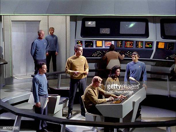 The crew on the bridge of the USS Enterprise John Hoyt as Dr Phillip Boyce standing in back with hands behind his back Jeffrey Hunter as Captain...