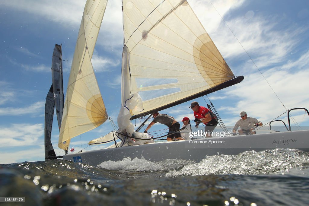 The crew onboard 'Amigos' trim the sails during the Sydney Regatta on Sydney Harbour, on March 10, 2013 in Sydney, Australia.