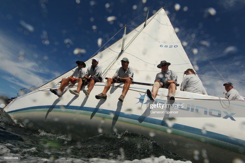 The crew onboard 'Equinox' ride the rail during the Sydney Regatta on Sydney Harbour, on March 10, 2013 in Sydney, Australia.