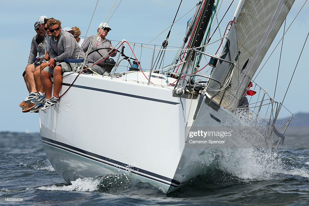 The crew onboard 'Exile' ride the rail during the Sydney Regatta on Sydney Harbour, on March 9, 2013 in Sydney, Australia.