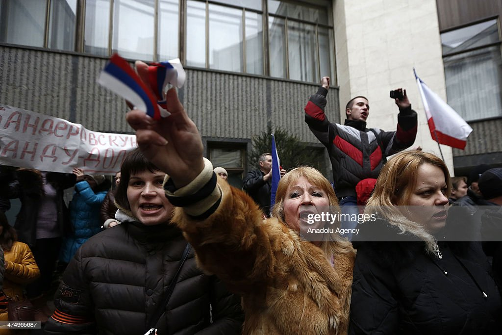 The Crimean people and the supporters of Russia gather in front of the Parliament building in the Autonomous Republic of Crimea's capital Simferopol, Ukraine, on February 26, 2014. The Crimean people shout slogans for the unity of the country at the same time the Russian people shout slogans to support their country.