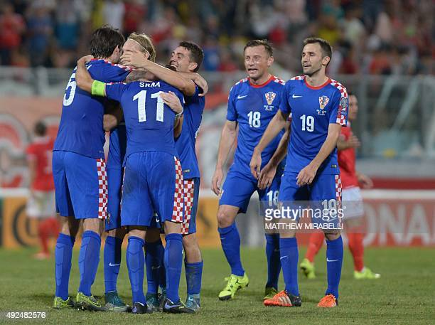 The Croatian national football team celebrates after beating Malta 10 in the Euro 2016 qualifying football match between Malta and Croatia on October...