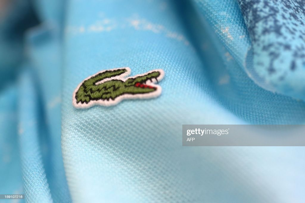 The crocodile shaped logo of French apparel company Lacoste is pictured on a polo, on January 7, 2013 in Troyes.