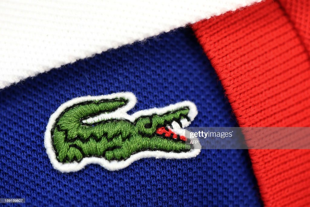 The crocodile shaped logo of French apparel company Lacoste is pictured on a polo, on January 9, 2013 in Paris. AFP PHOTO THOMAS SAMSON