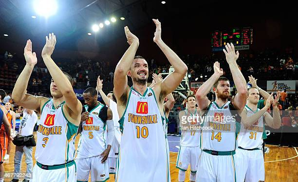 The Crocodiles acknowledge the crowd after winning the round 17 NBL match between the Cairns Taipans and the Townsville Crocodiles at Cairns...