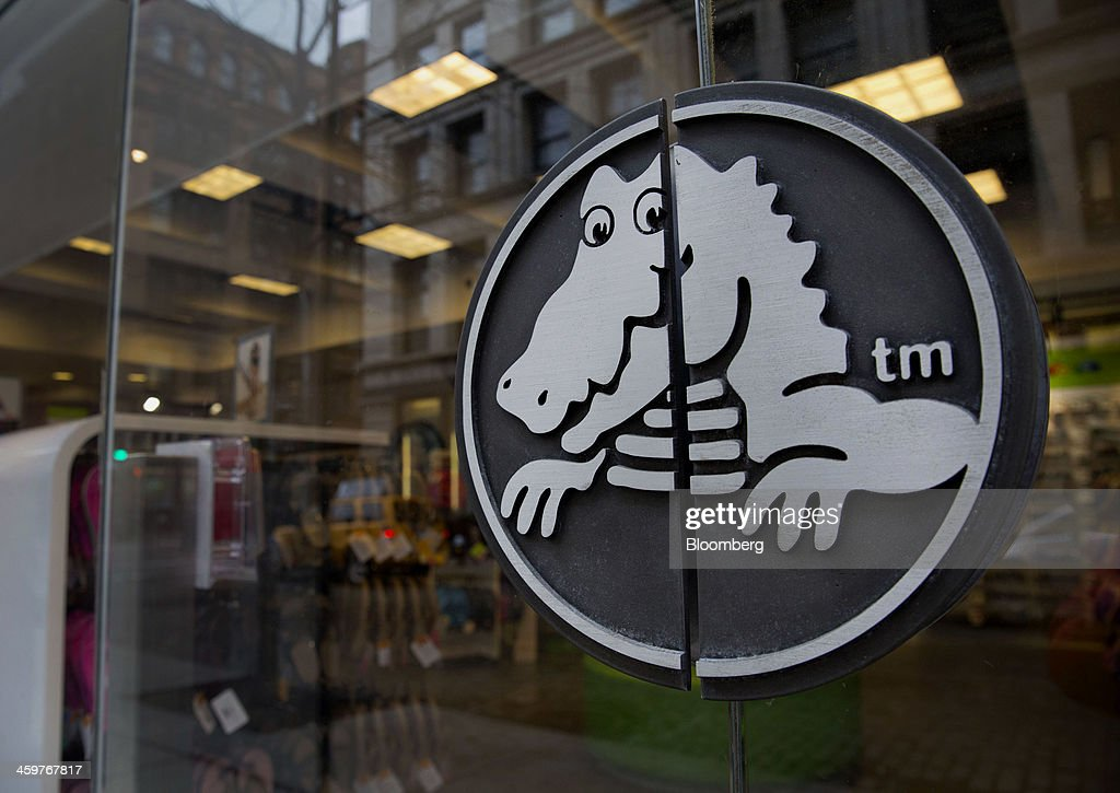 The Crocs Inc. logo is displayed at a store in New York, U.S., on Monday, Dec. 30, 2013. Crocs Inc. rose as much as 14 percent in early trading after saying Chief Executive Officer John McCarvel will retire and Blackstone Group LP will invest $200 million in the maker of colorful plastic clogs. Photographer: Jin Lee/Bloomberg via Getty Images