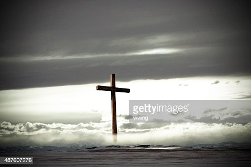 The Cross in winter mist and clouds with copy space