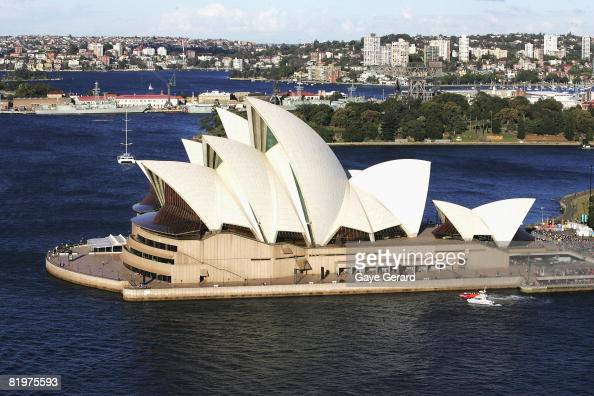 The Cross is transported to the Opera House by boat along Sydney Harbour with thousands of fans gathering along the Harbour shoreline to catch a...