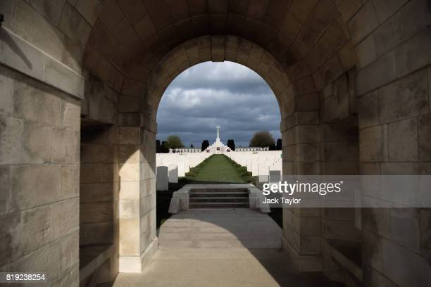 The Cross of Sacrifice and the rows of headstones are pictured through the entrance tunnel at the Tyne Cot Cemetery on April 5 2017 in Zonnebeke...