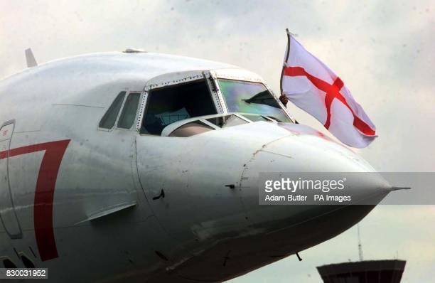 The Cross of St George is flown out of the front window of the Concorde that carries the England football team back home after their defeat last...