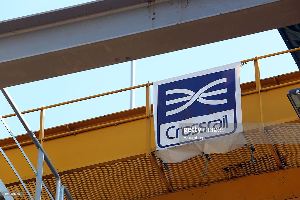 The Crossrail company logo is displayed on a walkway at the company's Westbourne Park construction site in London, U.K., on Tuesday, Feb. 19, 2013. Network Rail Ltd. projects include a 6 billion-pound upgrade to the Thameslink line that spans London from north to south and the Crossrail project to build an east-west line through the capital, Finance Director Patrick Butcher said. Photographer: Chris Ratcliffe/Bloomberg via Getty Images
