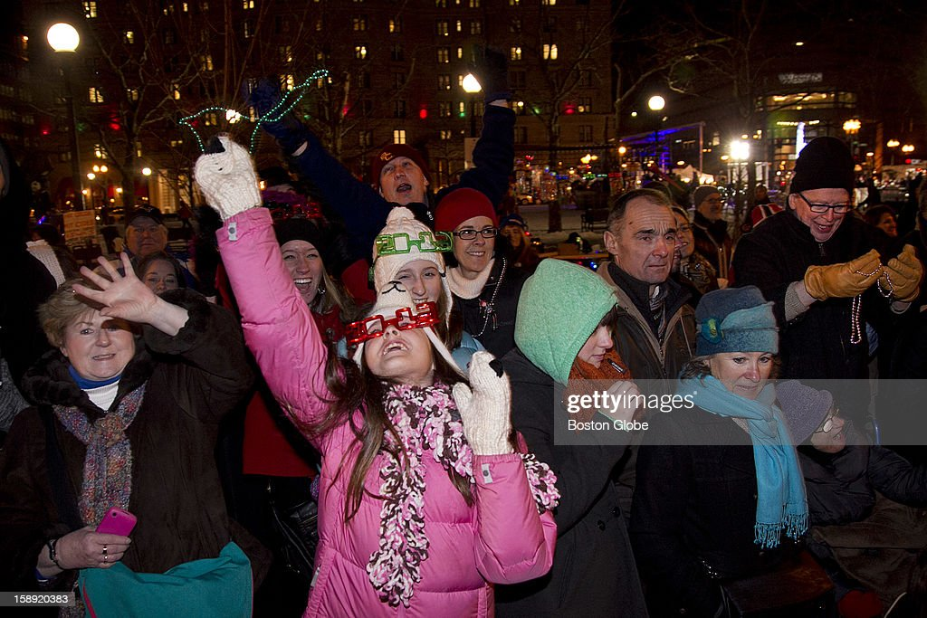 The crowd along Boylston Street catches beads as the Grand Procession goes by during First Night, Boston's New Year's Eve celebration, on Monday, December 31, 2012.